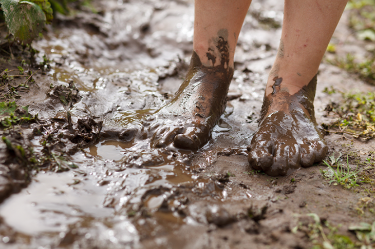 Childs-Feet-in-Mud